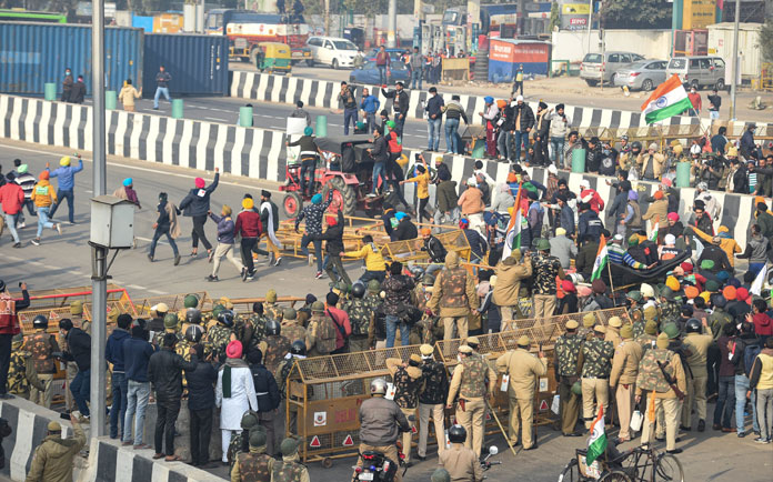Violence in Delhi after farmers take out rally