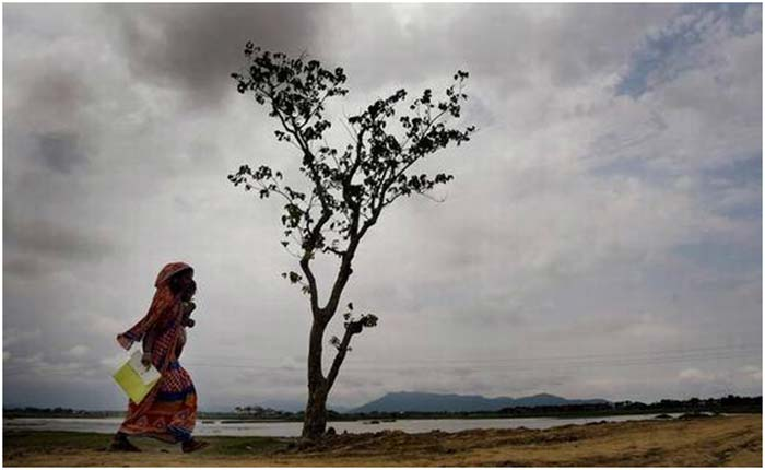 Published in the Hindu on August 31, 2019. A woman is on her way to check her name in the final list of the National Register of Citizens at Pabhokathi village in Assam's Morigaon district on August 31, 2019.   | Photo Credit: Ritu Raj Konwar